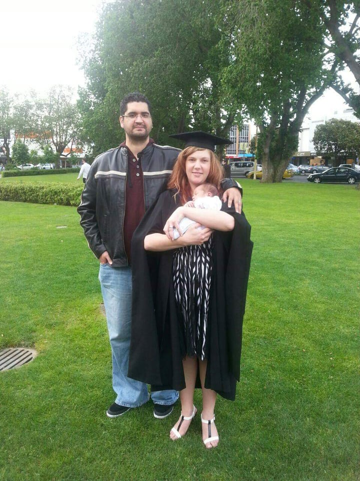 Lainey Graduation with husband and new born son, Andre by her side