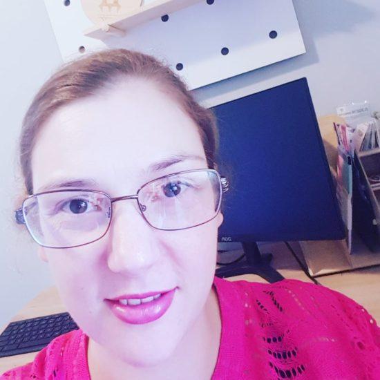 Lainey, founder of Rocket Fuel Design at her desk
