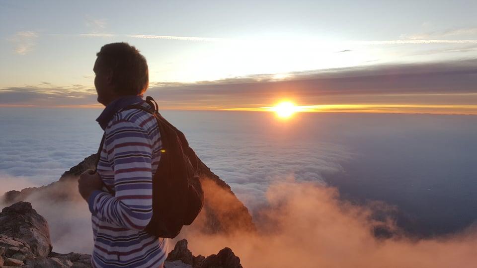 Kate partner enjoying the sunrise on the summit of Mt Taranaki